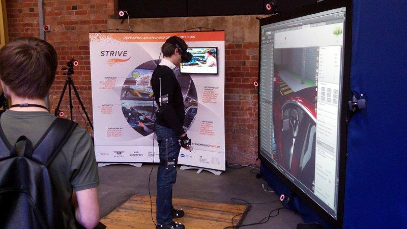 A visitor checks the virtual cockpit of a Tesla Model S